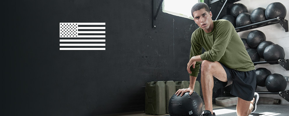 young man working in soffe performance tee shirt anchored in the military grounded in training