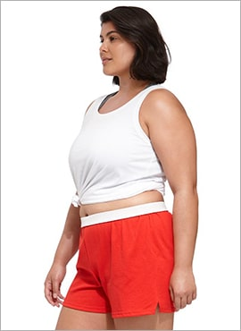 close up curvy woman wearing soffe cheer shorts in red